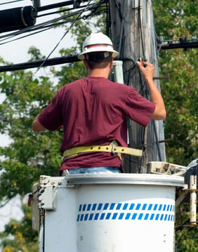 lineman tapping into a telephone line